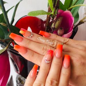trending neon orange ombre acrylic nail extensions