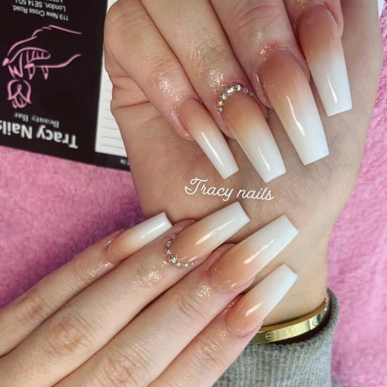 white ombre acrylic nail extensions with coffin shaped style